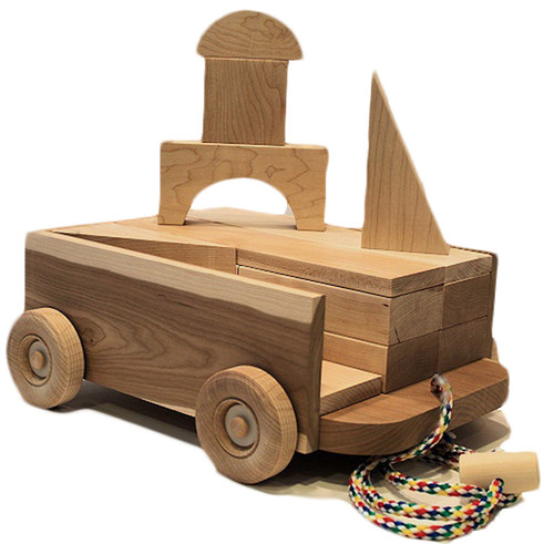 "Looking for a wagon on a rope filled with blocks like you played with yourself? Our 11""long  x 8"" wide cherry wagon is filled with 23 maple blocks in assorted shapes: squares, rectangles, triangles and the all-important arch for building a tunnel.  Finished with fine sanding. Why? So there are no paint chips or stains that might end up in a child's mouth. And because finely sanded hardwood is beautiful and smooth as glass."""