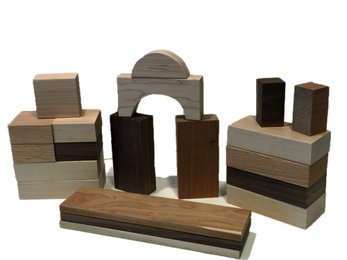 A crafted a set of twenty two blocks from cherry, walnut, maple and oak. The set includes six large rectangles, five squares, one arch, one half circle, four pillars, two half pillars and three planks. Finished with fine sanding. Why? So there are no paint chips or stains that might end up in a child's mouth. And because finely sanded hardwood is beautiful and smooth as glass.""
