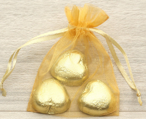 Organza Bags in gold for wedding favours or table gifts for company events, birthday parties or other celebrations