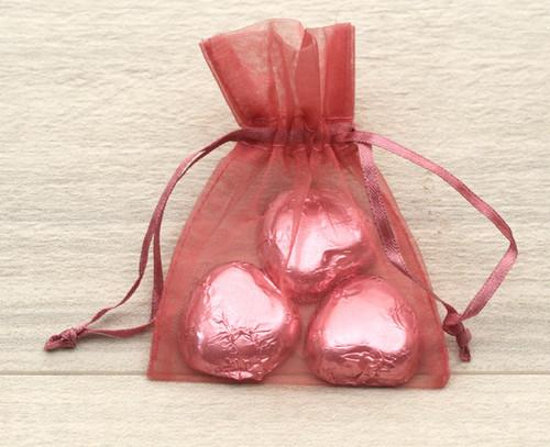 Dusky Pink Organza Bag with milk chocolate hearts