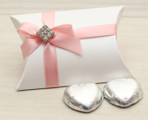 Table Gift in the shape of a Pillow Box with two solid milk chocolate hearts with a Pink satin ribbon and Diamante