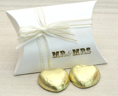 Table Gift in the shape of a Pillow Box  containing two solid milk chocolate hearts with an Ivory and Gold satin ribbon and printed with Mr & Mrs
