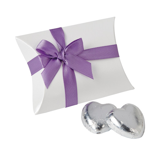 Pillow box table setting containing two solid milk chocolate hearts and ribboned with a violet satin ribbon.