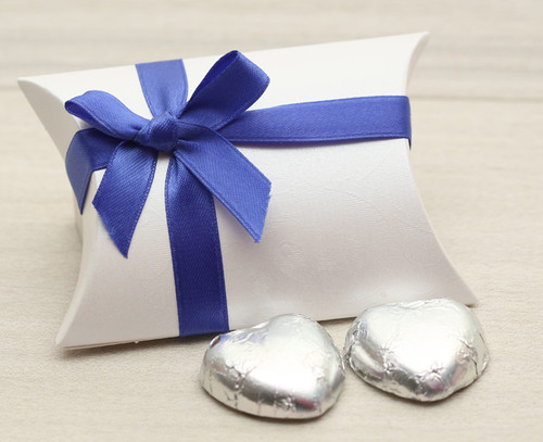 Table Gift in the shape of a Pillow Box with a Royal Blue Satin Bow. Contains two foil wrapped milk chocolate hearts