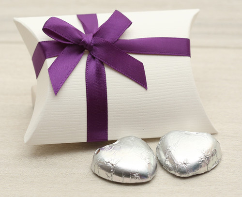 Table Gift in the shape of a Pillow Box with a Purple Satin Bow. Contains two foil wrapped milk chocolate hearts