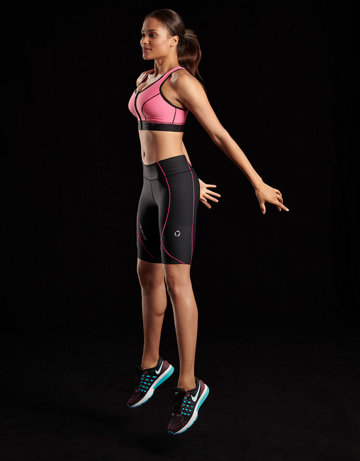 The 228 short compression leggings for women, seen with the 100Z compression bra (sold separately)