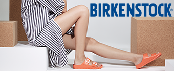 Woman sitting on a step wearing Birkenstock