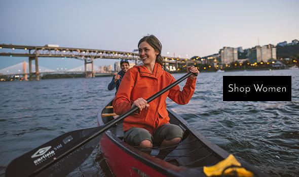 Woman in a Canoe in water wearing Columbia