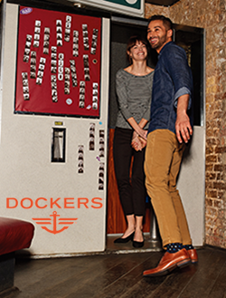 Man and woman going into a photobooth wearing Dockers