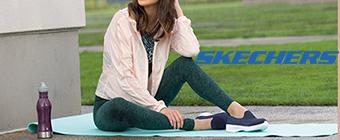 Woman sitting on a yoga mat wearing Skechers