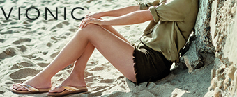 Woman sitting in the sand wearing Vionic