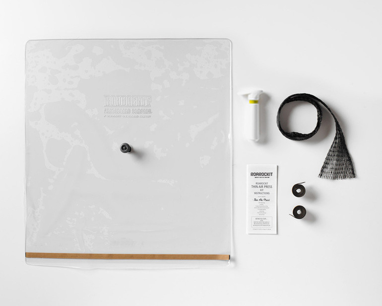 The Roarockit Thin Air Press Kit Parts: vacuum bag with seal and one-way valve, pump, breather, extra seals and illustrated instructions