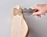 The specially shaped woodworker's scraper is ideal for cleaning up a shaped edge in a flash!