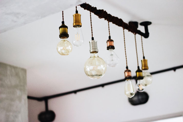 several light bulbs descend from the ceiling