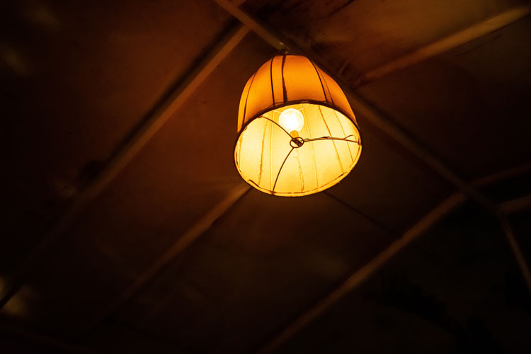 an overhead light shines from above