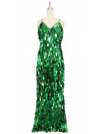 A long handmade sequin dress, in rectangular emerald green paillette sequins with silver faceted beads and a luxe grey fabric background in a classic cut front view