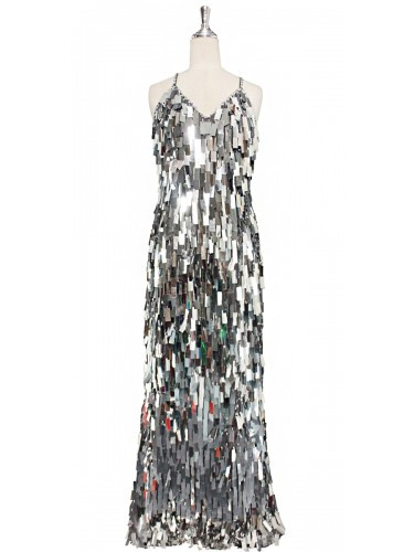 A long handmade sequin dress, in rectangular silver paillette sequins with silver faceted beads and a luxe grey fabric background in a classic cut front view