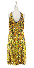 A short handmade sequin dress, in 20mm metallic iridescent gold paillette sequins with silver faceted beads, a luxe grey fabric backround and a halter neck cut front view