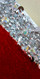 A long handmade fishscale sequin dress in red and  silver 10mm sequin spangles close up view