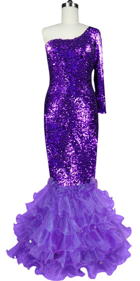 Long dress in metallic purple sequin spangles fabric with purple organza ruffles and one sleeve cut front view