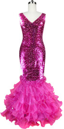 Long dress in metallic fuchsia sequin spangles fabric with fuchsia organza ruffles and cowl back front view