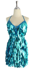 A short handmade sequin dress, in rectangular metallic turquoise color sequins front view