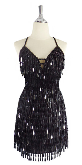 A short handmade sequin dress, with tear-drop shaped black paillette sequins front view