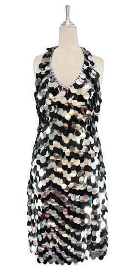 A short handmade sequin dress, in 30mm mixed black and metallic silver paillette sequins front view
