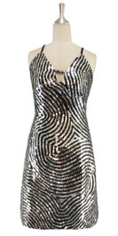 A short handmade sequin dress, in 10mm black and metallic silver swirl patterned sequins front view