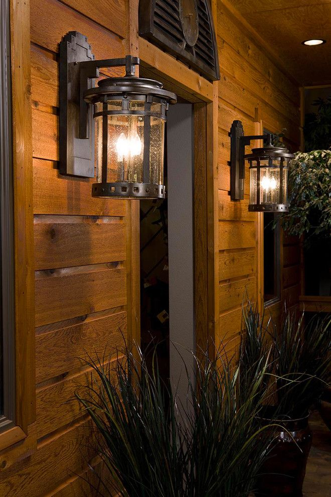 hacienda style iron lamp from Mexico iluminating exterior of the house