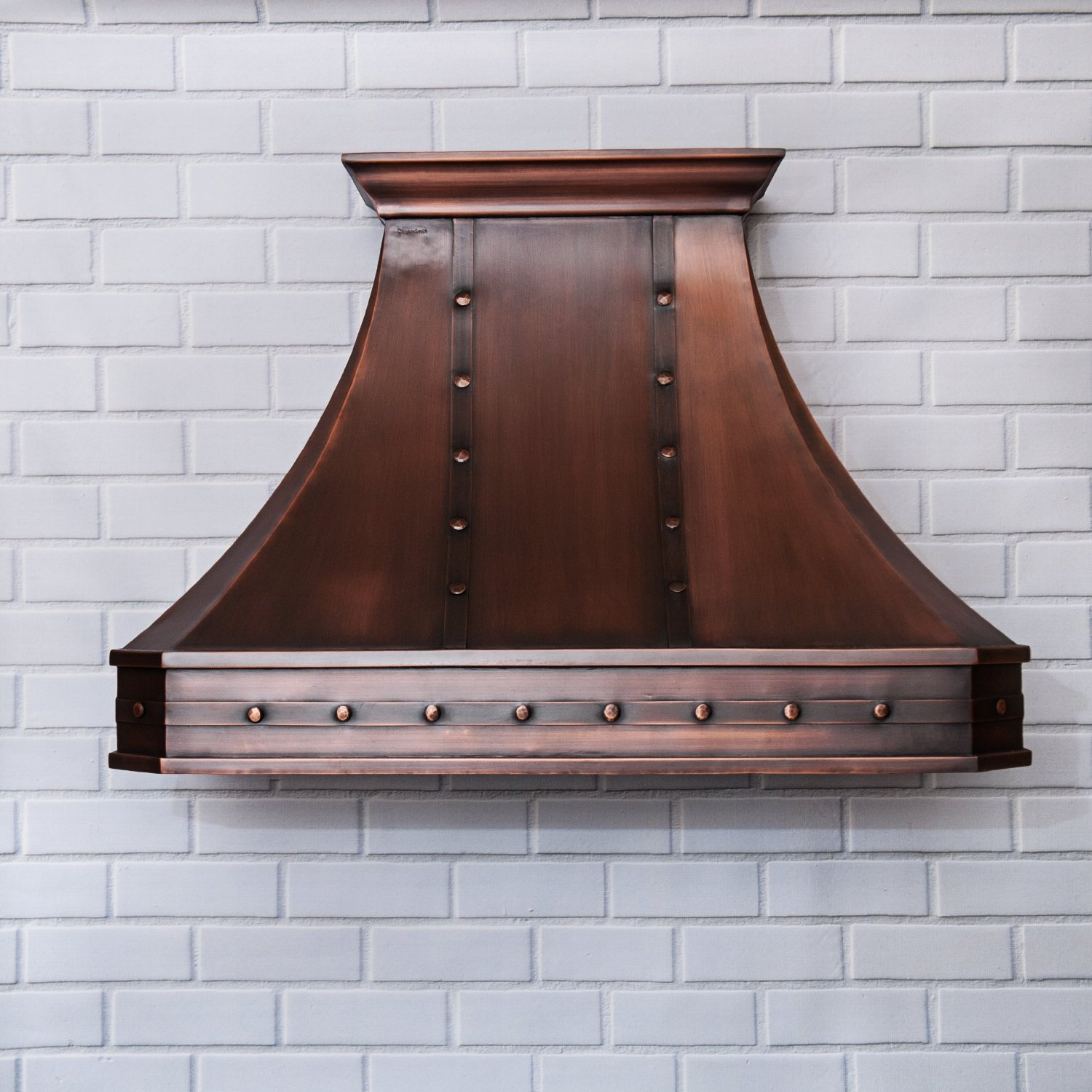 hand hammered copper vent hood with straps in a kitchen