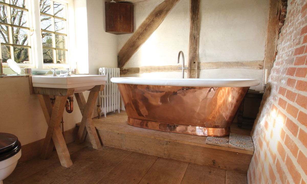 household copper tub in a bathroom