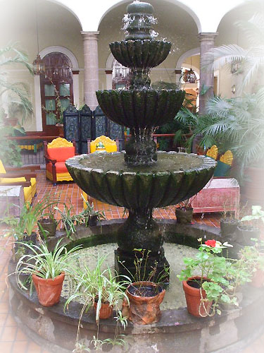 mexican stone fountain in a garden