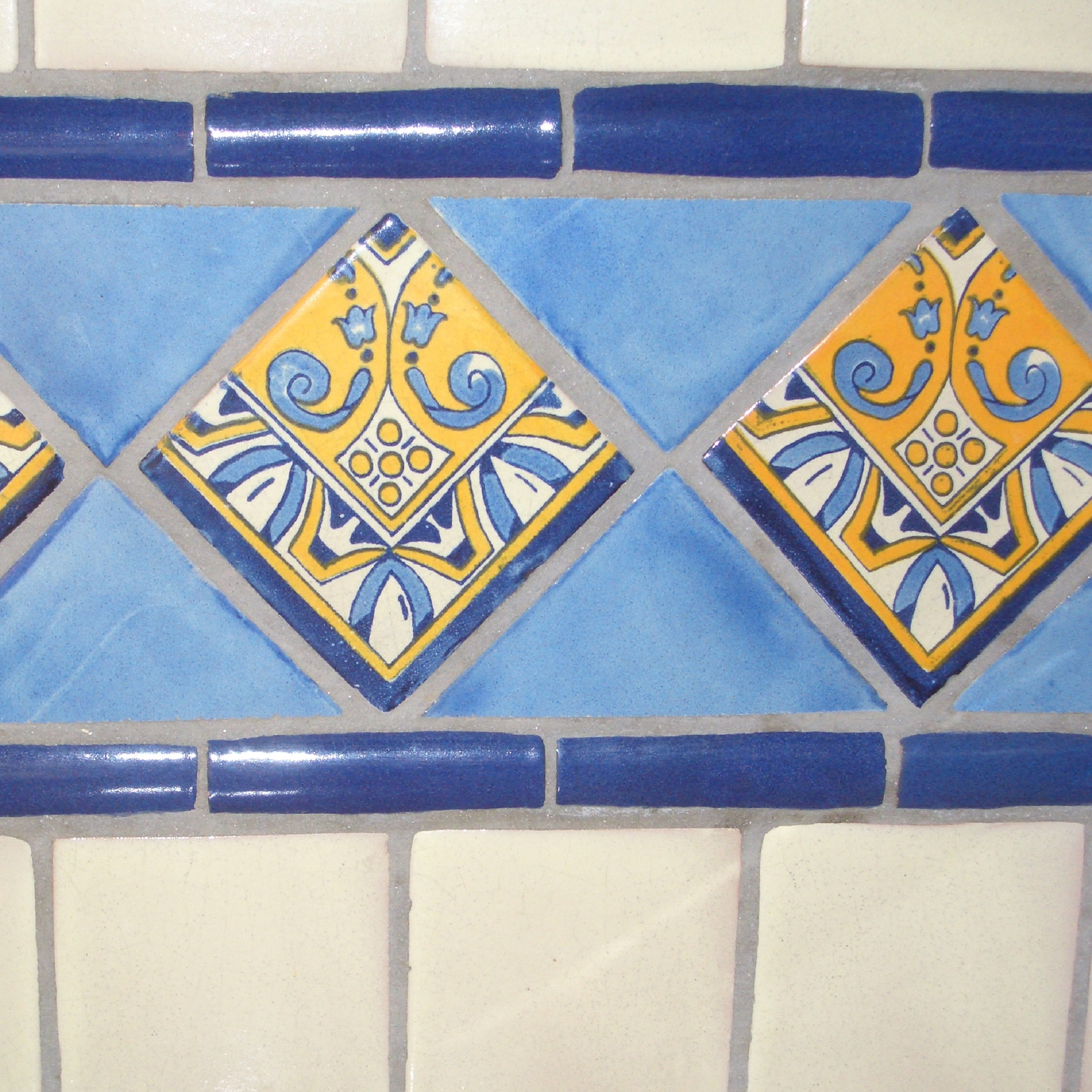 mexican ceramic tile accent in a kitchen wall