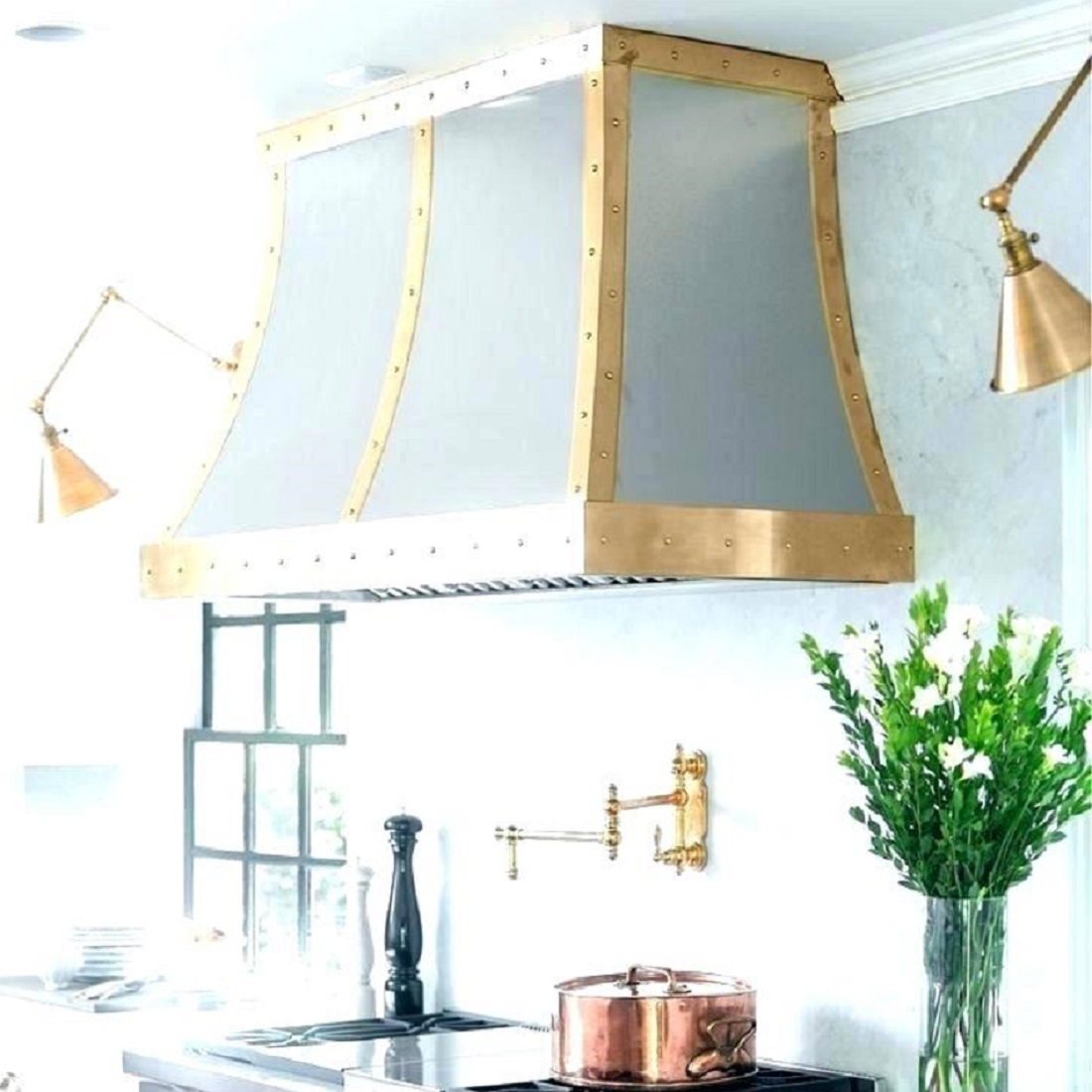wall mount brass range hood in a kitchen