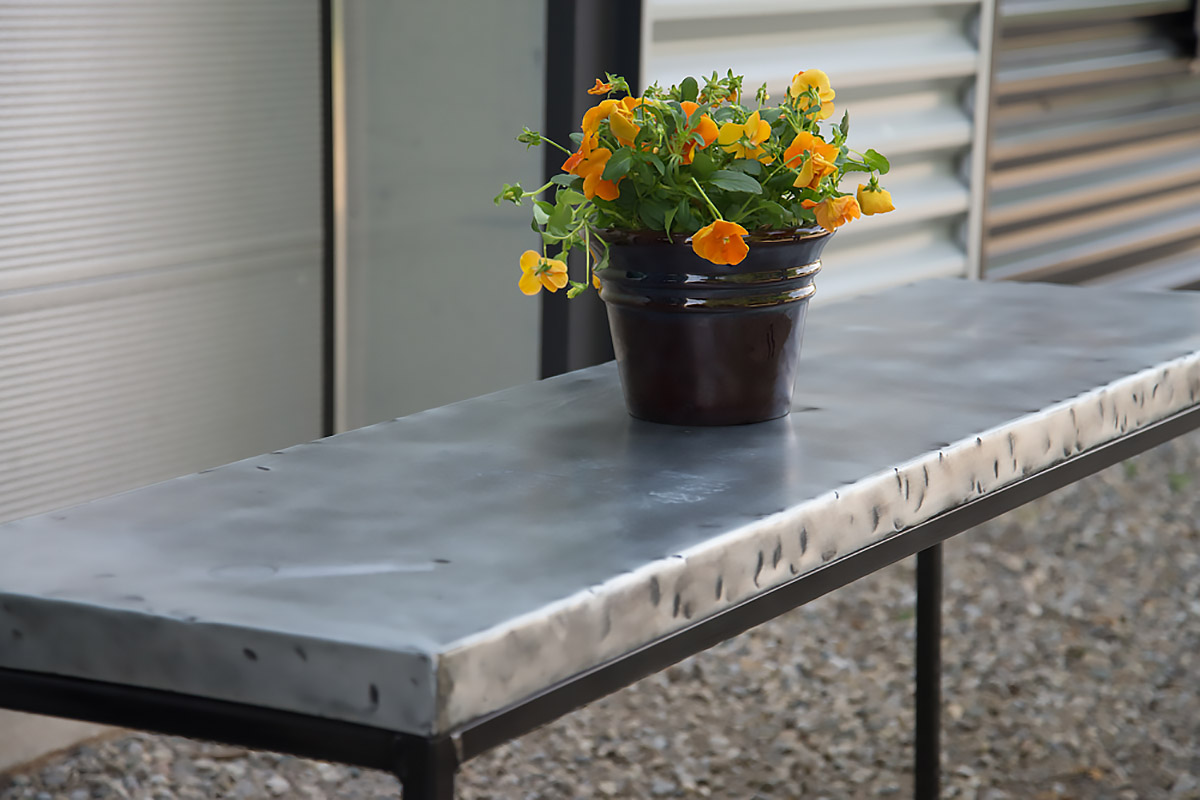 hammered zinc table-top in a dining room