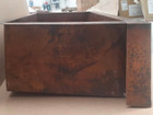 kitchen sink made of hammered copper side view