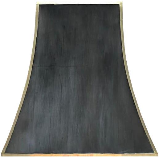 black metal range hood with brass straps