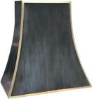 black range hood decorated with brass
