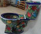 side view of Mexican toilet painted with a blue colibri pattern
