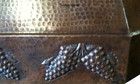 hammered copper oven hood apron grapes