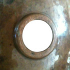 back view of moroccan bathroom sink designed in hammered copper