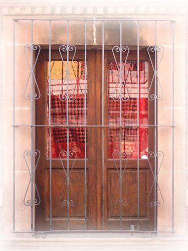 beautiful forged iron window guards