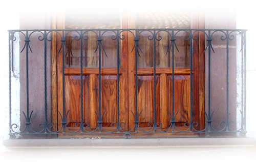 colonial influence forged iron balcony