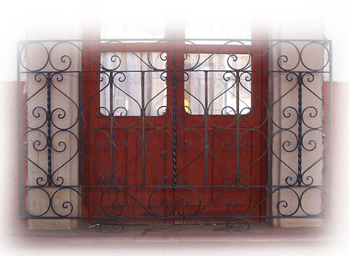 artisan crafted forged iron balcony