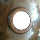 decorative copper bathroom sink detail view