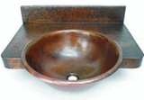 round copper bathroom sink with a counter