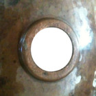 round Mexican copper bathroom sink drain view