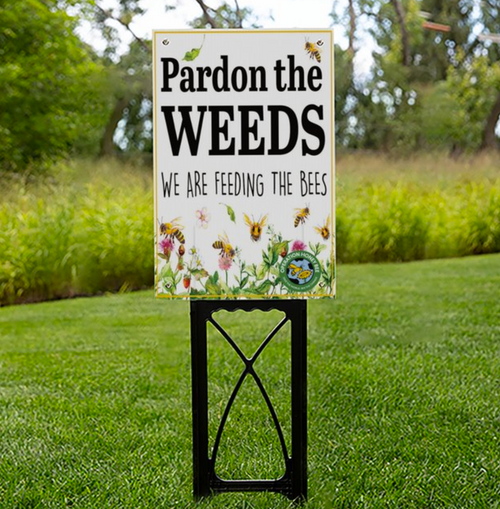 "Pardon The Weeds - Save The Bees - OHB Exclusive Sign   Place this sign in your yard during dandelion season, ""Spring - Early Summer."" Bees are already under tremendous pressure along with a loss of habitat for food. Did You Know? Dandelions provide a necessary food source and if you spray your dandelions you are putting chemicals in your lawn that are killing bees. Did you also know that even if you spray you yard 2-3 times a year, dandelions will come back next year anyways?  Do you part and place this sign in your yard, business, or school."