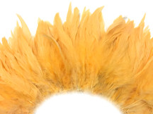 4 Inch Strip - Peach Bleached And Dyed Strung Rooster Schlappen Feathers